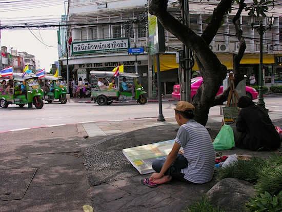 Local artists at work on the street in old town Bangkok